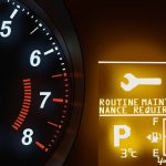 1- Understanding the Mitsubishi Mileage-Based Reminder System – showing Mitsubishi display with routine maintenance required _ check engine light illuminated